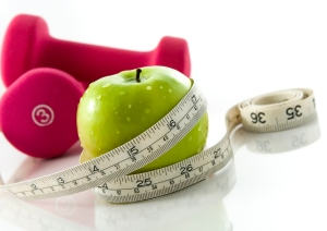 Picture of weights, measuring tape and healthy apple