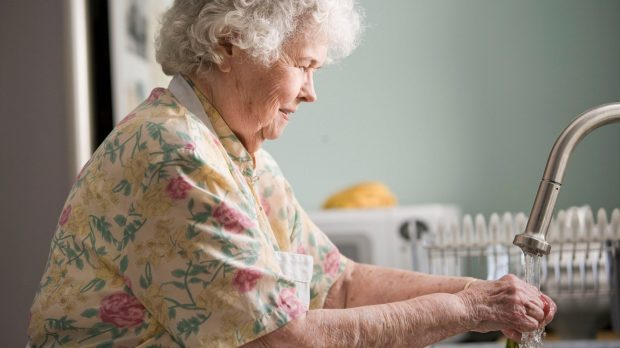 Picture of an older woman washing her hands
