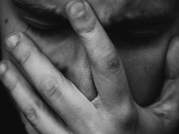 person grabbing face